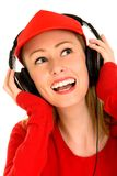 Woman with Headphones. Young woman listening to music Stock Images