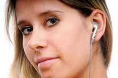 A woman with headphones Royalty Free Stock Photo