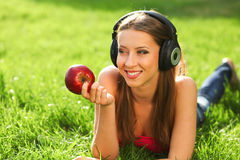 Woman with headphones Royalty Free Stock Photography