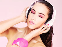 Woman with headphones. Pretty young woman enjoying music on headphones royalty free stock photography