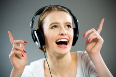 Woman in headphones Stock Photos