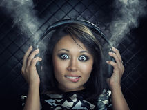 Woman with headphones. Listening to music Royalty Free Stock Photo