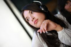 Woman in headphones Stock Photo