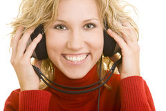 Woman with headphones. Blonde woman with headphones smiling royalty free stock photo