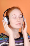 Woman in headphones stock photography