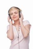 Woman in headphones. Stock Photos