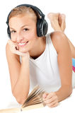 Woman With Headphones and Book Royalty Free Stock Photo