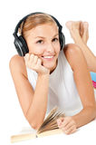 Woman With Headphones and Book Royalty Free Stock Image
