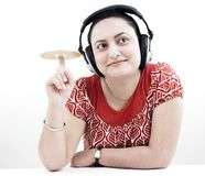 Woman with headphones and cd Royalty Free Stock Photos