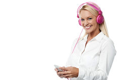 Woman with headphones and cell phone Royalty Free Stock Photos