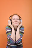 Woman in headphones close-up Stock Photography