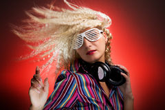 Woman with headphones dancing Stock Image