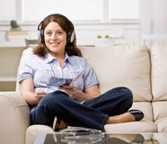 Woman in headphones enjoying listening to music Royalty Free Stock Photo