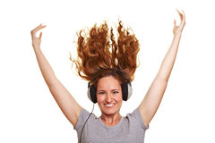 Woman with headphones and flying Royalty Free Stock Image