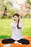 Woman with headphones in garden Royalty Free Stock Images