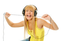 Woman in headphones gnaw cable Royalty Free Stock Photo