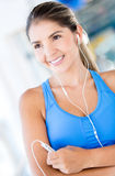 Woman with headphones at the gym Royalty Free Stock Photo