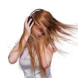 Woman with headphones and hair in motion Royalty Free Stock Images