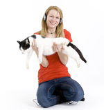 Woman in headphones with her lovely cat Royalty Free Stock Photography