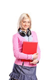 Woman with headphones holding a notebook Royalty Free Stock Photos