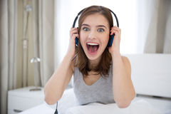 Woman with headphones at home Stock Photo