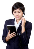 Woman with headphones. Image of business asian woman with headphones and see tablet on white background Stock Photo
