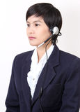 Woman with headphones. Image of business asian woman with headphones on white background Royalty Free Stock Photo