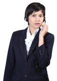 Woman with headphones. Image of business asian woman with headphones on white background Royalty Free Stock Photography