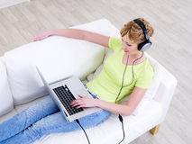 Woman in headphones with laptop Royalty Free Stock Photos