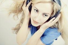 Woman headphones on light background Stock Photos