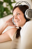 Woman with headphones  listen to music in lounge Royalty Free Stock Images