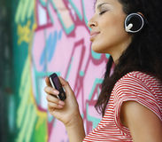 Woman with headphones listen to music pop Royalty Free Stock Photos