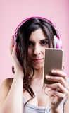 Woman in headphones listening mp3 music Royalty Free Stock Photography
