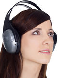 Woman in headphones listening music Stock Photo