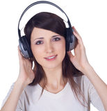 Woman in headphones listening music Stock Images