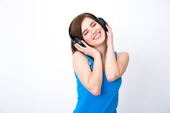 Woman with headphones listening music with closed eyes Stock Photos