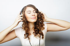 Woman with headphones listening music. Music  girl dancing against isolated white background Stock Photos