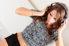 Woman in headphones listening music mp3 relaxing Stock Photo