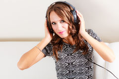 Woman in headphones listening music mp3 relaxing Stock Images