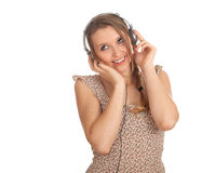 Woman in headphones listening music from mp3 Royalty Free Stock Photos