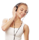 Woman with headphones listening music . Music teenager girl isol Royalty Free Stock Photos