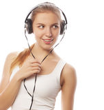 Woman with headphones listening music . Music teenager girl isol Royalty Free Stock Image