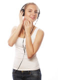 Woman with headphones listening music . Music teenager girl isol Stock Images