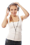 Woman with headphones listening music . Music teenager girl isol Stock Photos