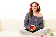 Woman with headphones listening music Stock Images