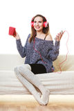 Woman with headphones listening music Stock Image