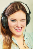 Woman with headphones listening music Royalty Free Stock Photos