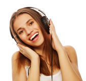 Woman with headphones listening music. Music teenager girl dancing against white. background isolated .r Stock Images