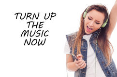 Woman with headphones listening music. Teenager girl dancing. Ea Royalty Free Stock Images