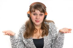 Woman with headphones is listening rock music stock images